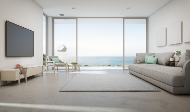 Sea view living room of luxury summer beach house with large glass door and wooden terrace. Premium Photo