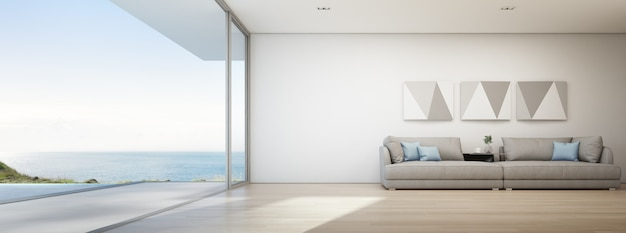 Sea view living room of luxury summer beach house with swimming pool and wooden terrace. Premium Photo