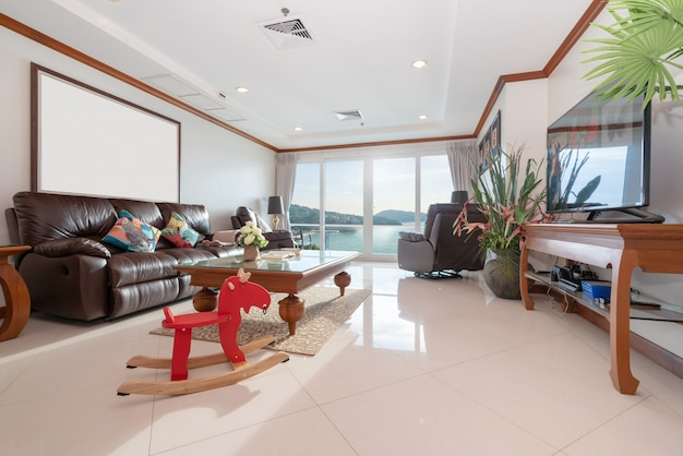 Sea view living room with wooden dining table Premium Photo