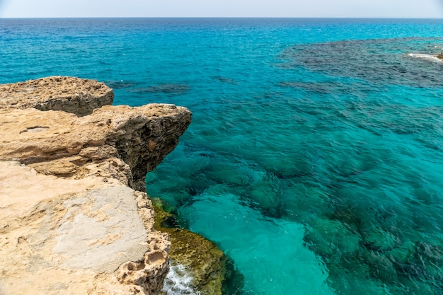 Sea waves beating against the rocky shore. Premium Photo