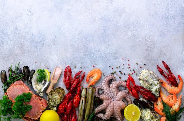 Seafood background on grey background Premium Photo