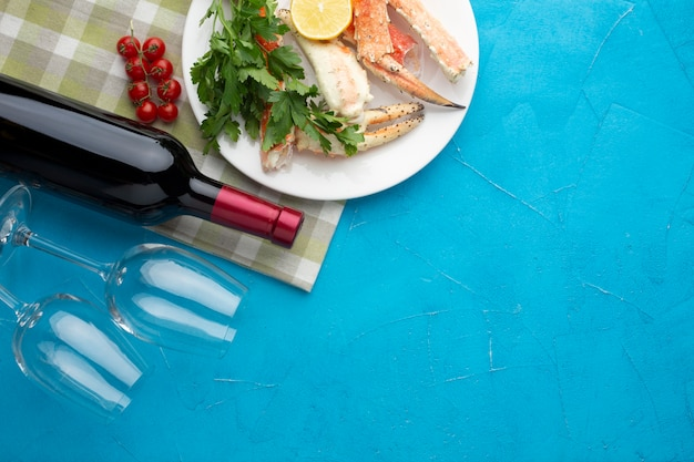 Seafood dish with wine bottle and glasses Free Photo