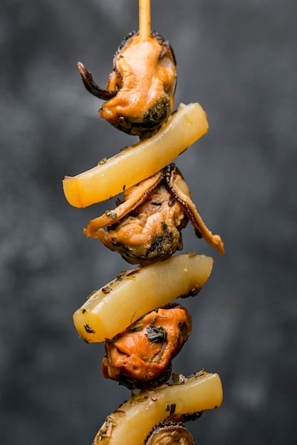 Seafood oysters on skewers Free Photo