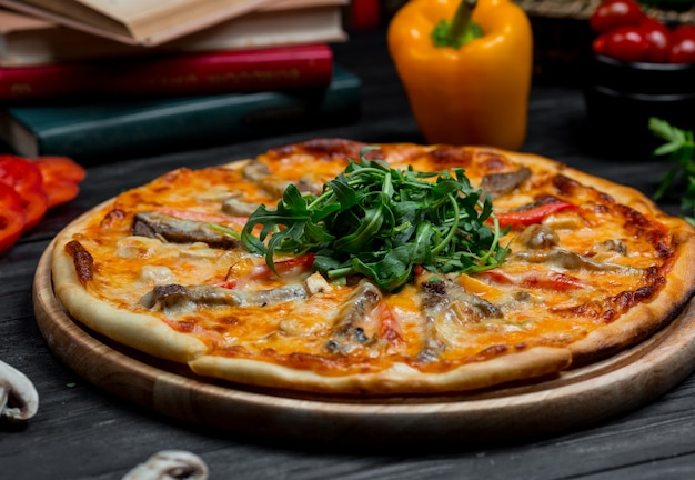 Seafood pizza with tomato sauce and finely melted cheddar cheese on the top Free Photo