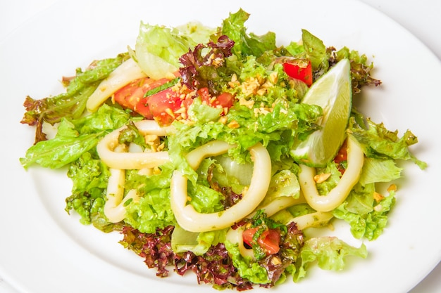 Seafood salad with calamari rings Free Photo