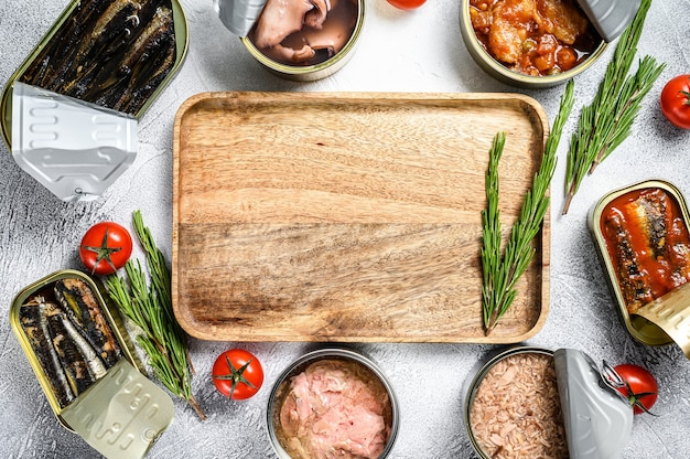 Premium Photo | Seafood snacks - canned sardines, mussels, octopus, salmon and tuna. gray background.