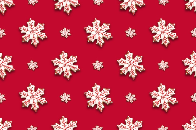 Seamless pattern of christmas gingerbread in shape snowflakes on red background. xmas background. Premium Photo