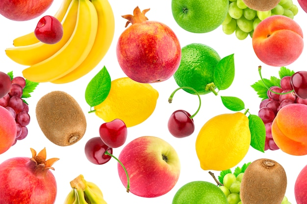 Seamless pattern of different fruits and berries. falling tropical fruits isolated on white background Premium Photo