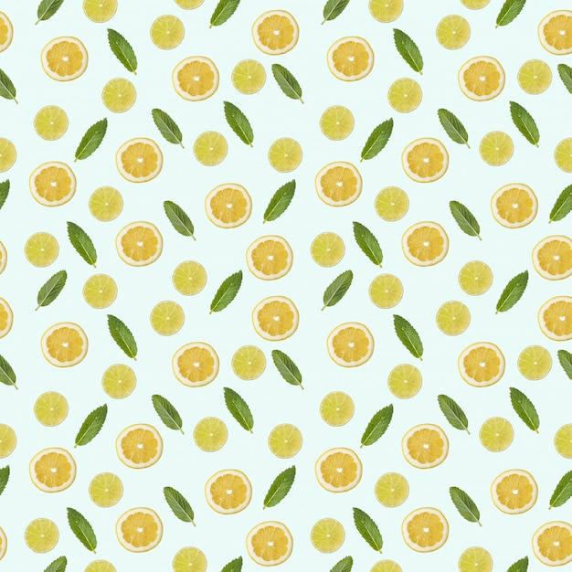 Seamless pattern with a picture of lemon, lime and mint. Premium Photo