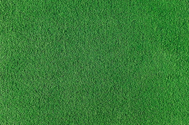 Seamless texture of artificial grass field. green texture of a football, volleyball and basketball field Premium Photo