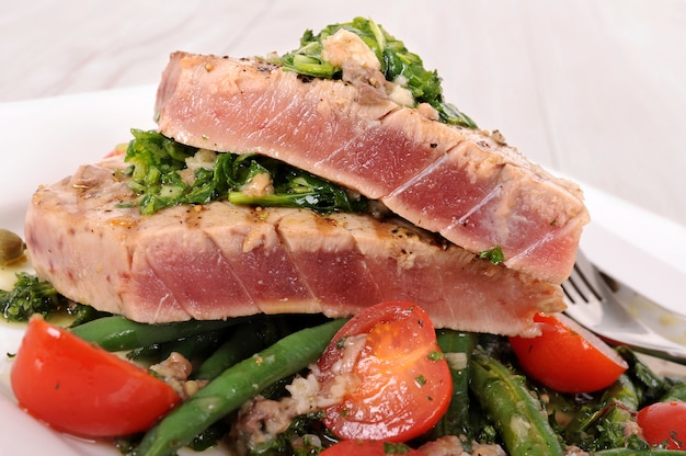 Seared tuna steak with vegetables close up Free Photo