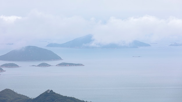 Seascape and mountain with clouds sky in the rain season Premium Photo