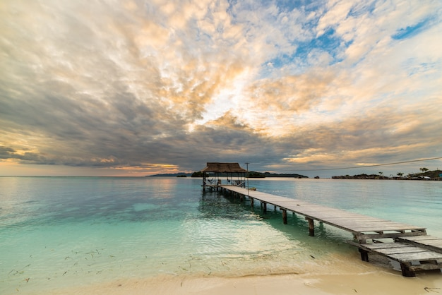 Seascape with wooden jetty at dusk, togian islands, sulawesi indonesia Premium Photo