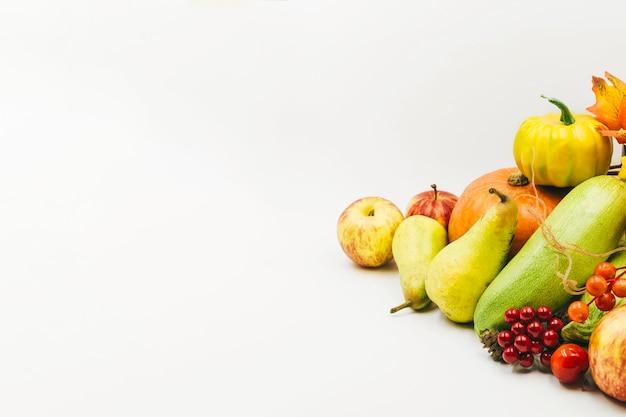 Seasonal harvest of berries and vegetables Free Photo