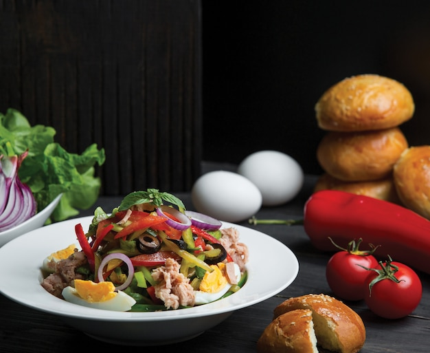 Seasonal salad with olives, eggs and onions Free Photo