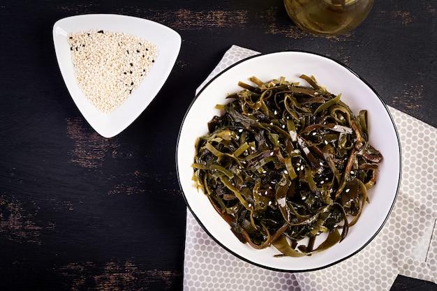 Seasoned seaweed salad and fresh herbs. top view. Premium Photo