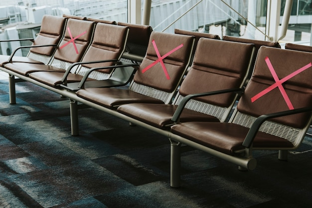 Seats marked with an x for social distancing during covid-19 Free Photo