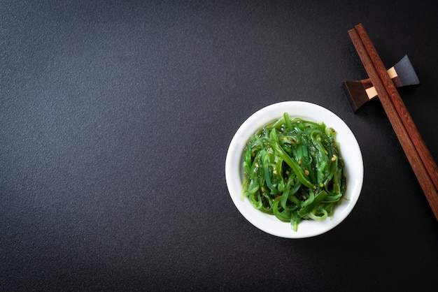 Seaweed salad - japanese style black background with copyspace Premium Photo