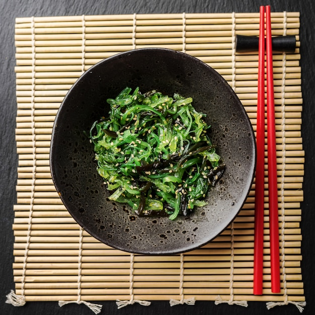 Seaweed salad served and ready to eat Free Photo