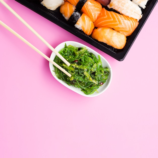 Seaweed salad with a big sushi plate Free Photo