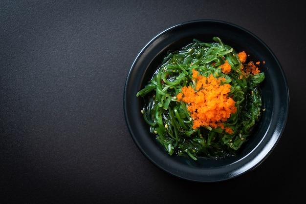 Seaweed salad with shrimp eggs - japanese style, copyspace background Premium Photo