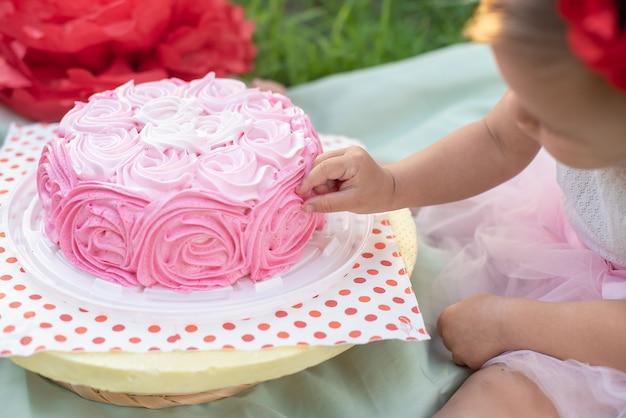 Second birthday of little girl. cake smash. Premium Photo