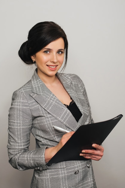 Secretary Girl In Business Suit With Documents And Beautiful Smile