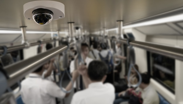 Security camera monitoring attach on ceiling subway Premium Photo
