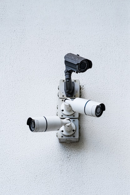Security cameras on white modern building, technology concept Free Photo