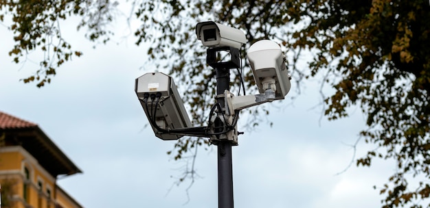 Security cctv cameras on a lamp post in the park Premium Photo