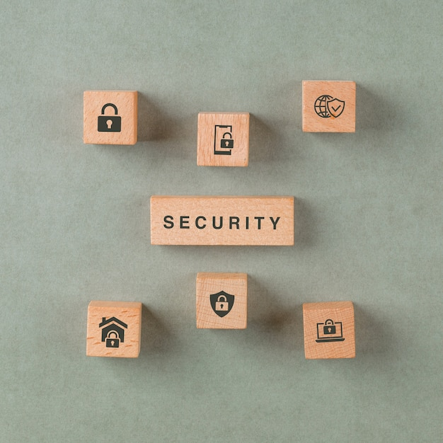 Security concept with wooden blocks with icons. Free Photo