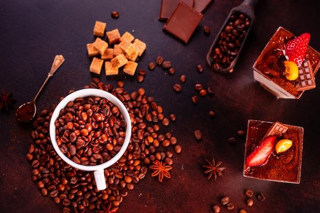Seeds of fragrant coffee on a dark concrete background Premium Photo