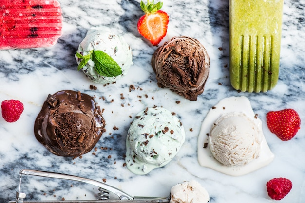 Selection of different ice cream scoops such as mint, chocolate and strawberry Premium Photo