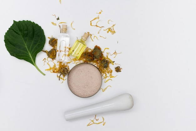 Selection of essential oils with herbs and flowers Free Photo