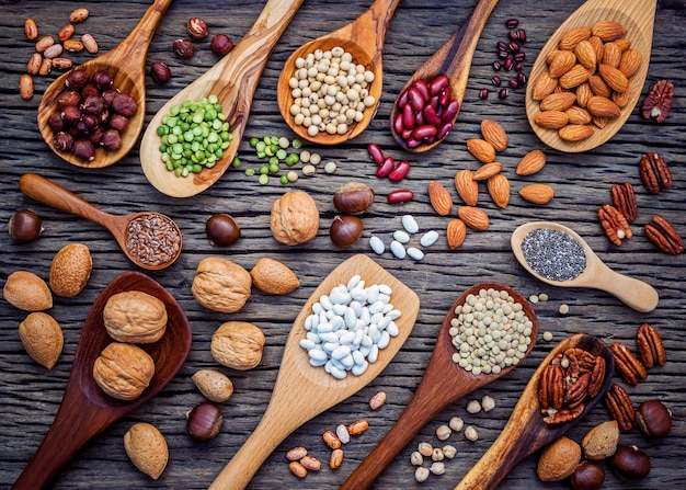 Selection food sources of omega 3 and unsaturated fats on wooden background. Premium Photo