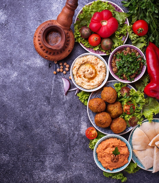 Selection of middle eastern or arabic dishes. Premium Photo