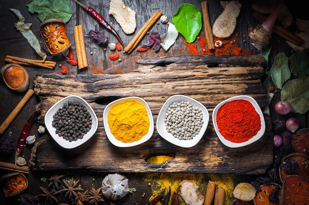 Selection of spices herbs and ingredients for cooking, food background on wooden table Premium Photo