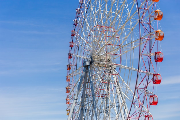 Selective focus of beautiful colorful ferris wheel and the blue sky with copy space Premium Photo
