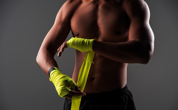 In selective focus of human hands tied with boxing hand wraps Premium Photo
