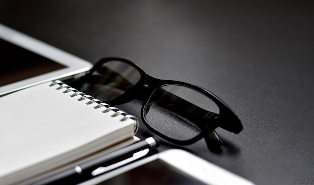 Selective focus of luxury office accessories in black and white Premium Photo