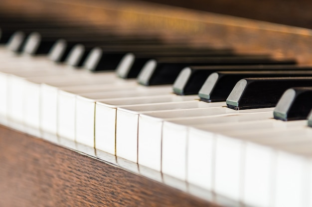 Selective focus point on vintage piano keys Free Photo