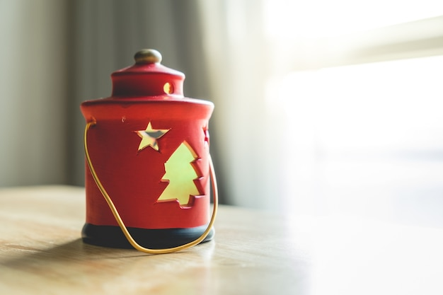 Selective focus with christmas red lamp decoration on wood table Premium Photo