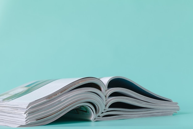 Selective soft focus of open and stacking of magazines Premium Photo