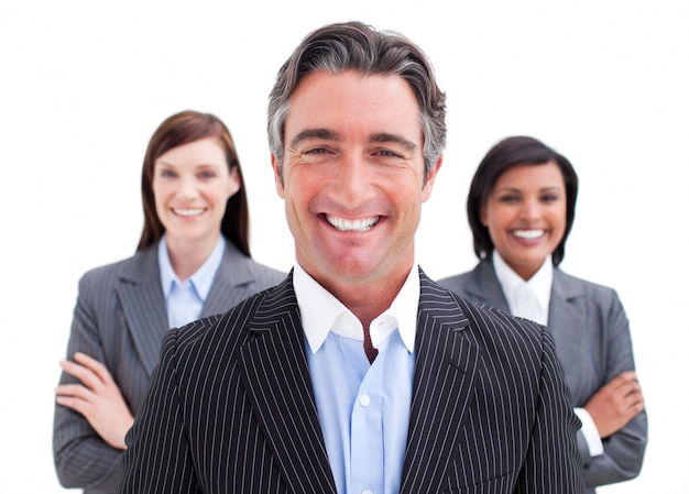 Self-assured businessman posing in front of his team Premium Photo
