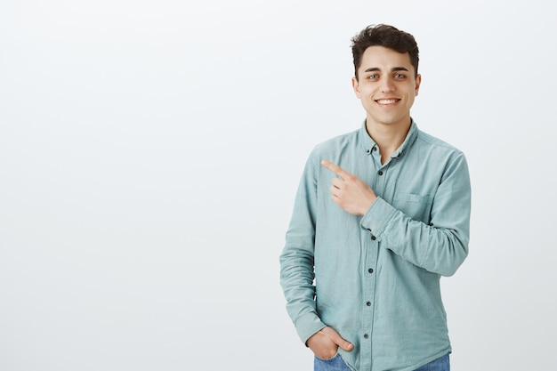 Self-assured happy european male in trendy shirt Free Photo