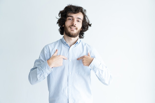 Self-assured young man pointing at himself Free Photo
