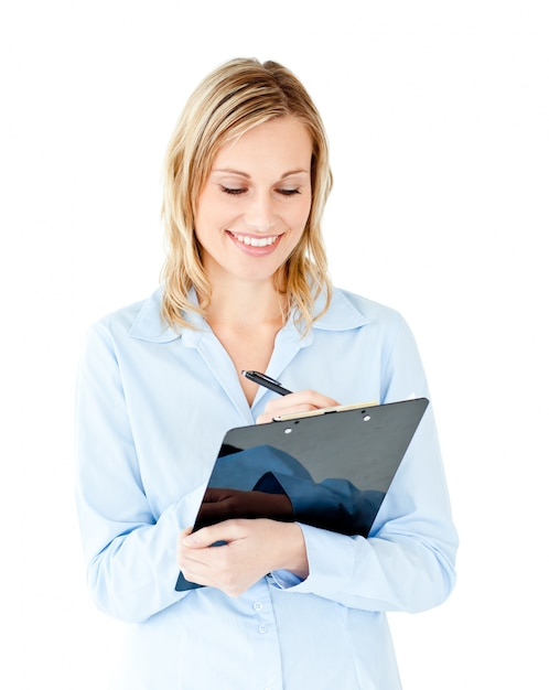 Self-confident businesswoman taking notes on a clipboard Premium Photo