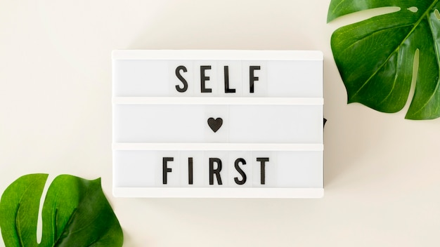 Self love first message with monstera plant Premium Photo