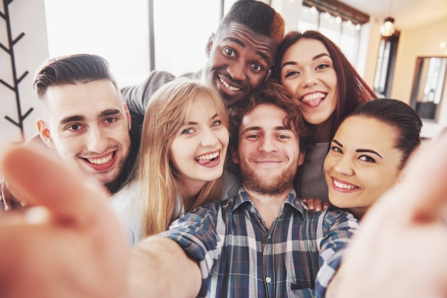 Self portrait of mixed race unity of african, american, asian, caucasian friends Premium Photo