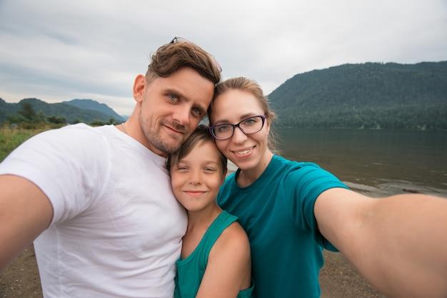 Selfie of family on the teletskoye lake Premium Photo